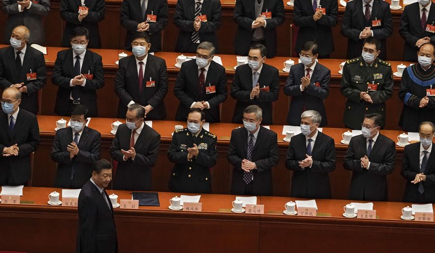 Delegates wearing face masks to help curb the spread of the coronavirus applaud as Chinese President Xi Jinping arrives for the opening session of Chinese People's Political Consultative Conference (CPPCC) at the Great Hall of the People in Beijing, Thursday, March 4, 2021. (AP Photo/Andy Wong)