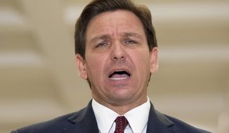 Florida Gov. Ron DeSantis speaks to the press after giving his State of the State speech on the first day of the 2021 Legislative Session in Tallahassee, Fla. Tuesday, March 2, 2021. (Tori Lynn Schneider/Tallahassee Democrat via AP)
