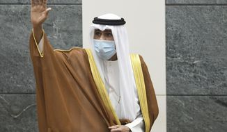 FILE - In this Sept. 30, 2020 file photo, the new Emir of Kuwait Sheikh Nawaf Al Ahmad Al Sabah, waves after he was sworn in at the Kuwaiti National Assembly. Kuwait said Thursday, March 4, 2021, that the 83-year-old ruling emir of Kuwait has flown to the United States for medical checks, just months after ascending the throne. (AP Photo/Jaber Abdulkhaleg, File)