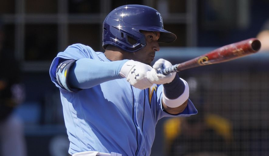 Tampa Bay Rays' Wander Franco hits a home run in the second inning during a spring training baseball game against the Pittsburgh Pirates on Wednesday, March 3, 2021, in Port Charlotte, Fla. (AP Photo/Brynn Anderson)