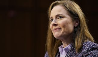 """FILE - In this Oct. 14, 2020 file photo, Supreme Court nominee Amy Coney Barrett speaks during a confirmation hearing before the Senate Judiciary Committee, on Capitol Hill in Washington.  Supreme Court justice Amy Coney Barrett has delivered her first opinion.  The 7-2 decision released Thursday is in a case about the federal Freedom of Information Act, which Barrett explains makes """"records available to the public upon request, unless those records fall within one of nine exemptions."""" Barrett wrote for the court that certain draft documents do not have to be disclosed under FOIA.  The 11-page opinion comes in the first case Barrett heard after joining the court in late October following the death of Justice Ruth Bader Ginsburg.  Justice Stephen Breyer and Justice Sonia Sotomayor dissented. (AP Photo/Susan Walsh, Pool)"""
