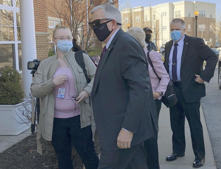 Missouri Gov. Mike Parson enters a St. Louis senior center on Thursday, March 4 in St. Louis. The center was the site of a coronavirus vaccination event. (AP Photo by Jim Salter)