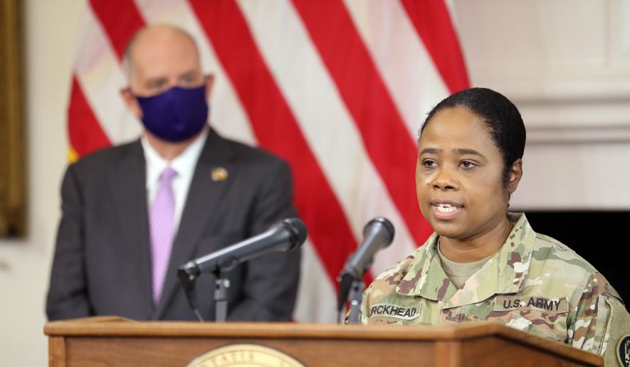 Brig. Gen. Janeen Birckhead, the Maryland National Guard's assistant adjutant general, outlines plans to improve equity in the distribution of COVID-19 vaccines in Maryland during a news conference in Annapolis, Md., on Thursday, March 4, 2021. Gov. Larry Hogan is standing left. (AP Photo/Brian Witte)