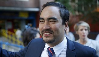 Tim Wu, a Democratic lieutenant gubernatorial candidate, speaks to reporters before voting in New York, Tuesday, Sept. 9, 2014. New York Gov. Andrew Cuomo faces a challenge in his bid for a second term in the Democratic primary as he seeks to dispatch liberal activist Zephyr Teachout.  (AP Photo/Seth Wenig)