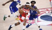 Washington Wizards guard Bradley Beal (3) dribbles the ball against Los Angeles Clippers guard Patrick Beverley (21) during the second half of an NBA basketball game, Thursday, March 4, 2021, in Washington. The Wizards won 119-117. (AP Photo/Nick Wass)