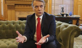 In this Dec. 20, 2018 file photo, then-Gov. Jeff Colyer answers questions during an Associated Press interview in his Statehouse office in Topeka, Kan. Colyer, who lost his 2018 Republican primary race, has signaled that he's planning to run for governor again in 2022 by appointing a campaign treasurer, a step required by law to raise money. (AP Photo/John Hanna)