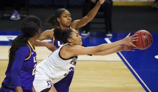 Texas A&M forward N'dea Jones, right, reaches for the ball against LSU guard Khayla Pointer, left, during the first half of an NCAA college basketball game during the Southeastern Conference tournament Friday, March 5, 2021, in Greenville, S.C. (AP Photo/Sean Rayford)