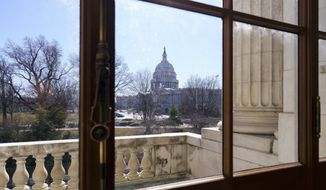 The Capitol is seen from the Russell Senate Office Building during a delay in work on the Democrats' $1.9 trillion COVID-19 relief bill, at the Capitol in Washington, Friday, March 5, 2021. (AP Photo/J. Scott Applewhite)