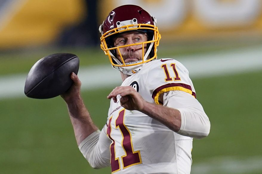 Washington Football Team quarterback Alex Smith (11) plays in an NFL football game against the Pittsburgh Steelers in Pittsburgh, in this Monday, Dec. 7, 2020, photo. (AP Photo/Keith Srakocic) **FILE**