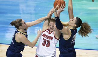 North Carolina State's Elissa Cunane (33) battles in the post against Georgia Tech's Lotta-Maj Lahtinen, left, and Lorela Cubaj, right, during an NCAA college basketball game in the semifinals of Atlantic Coast Conference tournament in Greensboro, N.C., Saturday, March 6, 2021. (AP Photo/Ben McKeown)