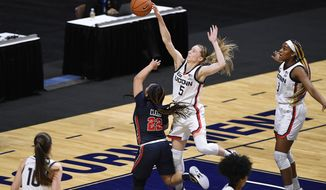 Connecticut's Paige Bueckers blocks a shot by St. John's Camree Clegg (22) during the first half of an NCAA college basketball game in the quarterfinals of the Big East Conference tournament at Mohegan Sun Arena, Saturday, March 6, 2021, in Uncasville, Conn. (AP Photo/Jessica Hill)