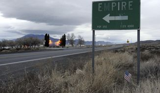 """A sign points to the town of Empire, Nevada off the highway leading to Gerlach and the Black Rock Desert in this photo taken in 2010. The town about 90 miles north of Reno was where actress Frances McDormand's character sets out from in the award-winning film """"Nomadland."""" (David B. Parker/The Reno Gazette-Journal via AP)"""