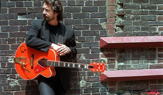Michael Stanley poses for a photo on June 2, 2000, in Cleveland, Ohio. Cleveland rocker Stanley has died at age 72 after battling lung cancer. Stanley's family says in a statement he died Thursday, March 4, 2021, in Cleveland, where he performed regularly and worked at rock radio station WNCX.  (Chuck Crow/The Plain Dealer via AP)