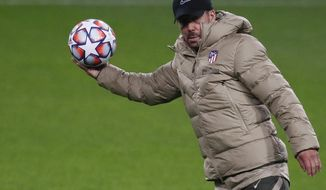FILE - In this file photo dated Monday, Nov. 2, 2020, Atletico Madrid's head coach Diego Simeone attends a training session in Moscow, Russia.  Diego Simeone's Atletico Madrid will try to deal a severe blow to Real Madrid's title defense on upcoming Sunday March 7, 2021. (Yuri Kochetkov/Pool FILE via AP)