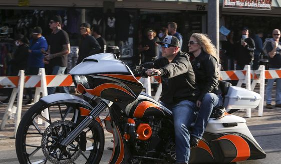 Bikers ride up and down Main Street in Daytona, Fla., during the start of Bike Week on Friday, March 5, 2021. (Sam Thomas /Orlando Sentinel via AP)
