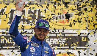 Kyle Larson celebrates after winning a NASCAR Cup Series auto race Sunday, March 7, 2021, in Las Vegas. (AP Photo/John Locher)