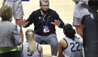 Connecticut head coach Geno Auriemma talks to his team during the second half of an NCAA college basketball game against Villanova in the Big East tournament semifinals at Mohegan Sun Arena, Sunday, March 7, 2021, in Uncasville, Conn. (AP Photo/Jessica Hill)