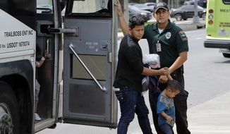 Immigrants are released after processing by U.S. Customs and Border Protection, often not aware that they may be spreading the coronavirus. (Associated Press)