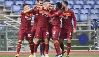 Roma's Gianluca Mancini, center, celebrates with teammates after scoring his side's opening goal during the Serie A soccer match between Roma and Genoa at the Rome Olympic Stadium Sunday, March 7, 2021. (Alfredo Falcone/LaPresse via AP)