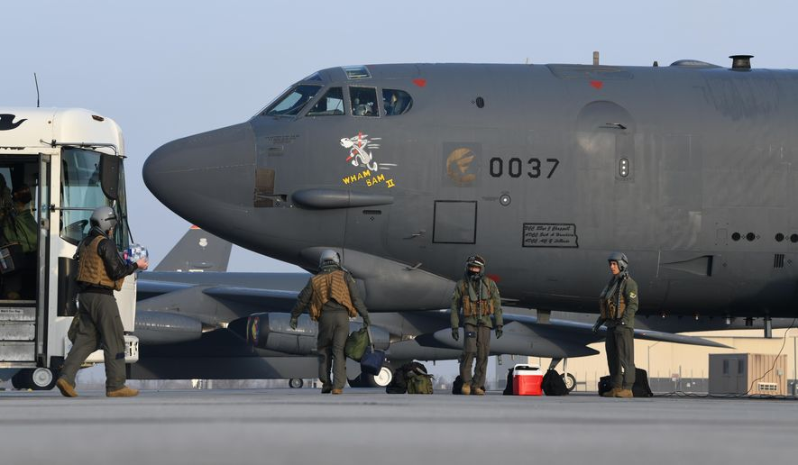 """Pilots from the 69th Bomb Squadron board B-52H Stratofortress bomber """"Wham Bam II"""" in preparation for a flight over the Mideast on March 6, 2021, at Minot Air Force Base, North Dakota. A pair of B-52 bombers flew over the Mideast on Sunday, March 7, 2021, the latest such mission in the region aimed at warning Iran amid tensions between Washington and Tehran. (U.S. Air Force/Senior Airman Josh W. Strickland via AP)"""
