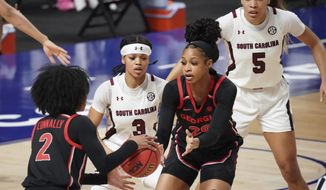 South Carolina guard Destanni Henderson (3) defends Georgia forward Jordan Isaacs (20) and Gabby Connally (2) during the first half of an NCAA college basketball game Sunday, March 7, 2021, during the Southeastern Conference tournament final in Greenville, S.C. (AP Photo/Sean Rayford)