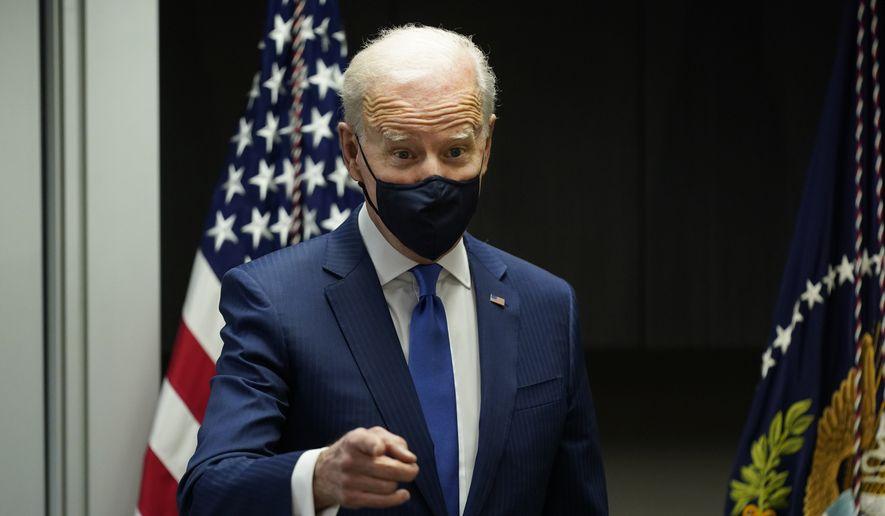 President Joe Biden visits a COVID-19 vaccination site at the VA Medical Center in Washington, Monday, March 8, 2021. (AP Photo/Patrick Semansky)