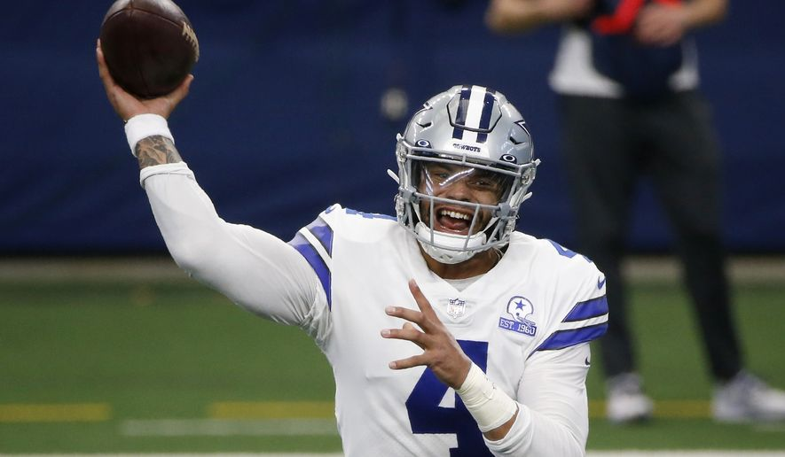 In this Oct. 11, 2020, file photo, Dallas Cowboys quarterback Dak Prescott throws a pass in the first half of an NFL football game against the New York Giants in Arlington, Texas. The Cowboys and Prescott have finally agreed on a contract two years after negotiations began with the star quarterback. The team the agreement was reached Monday, March 8, 2021, with further details to be announced. (AP Photo/Michael Ainsworth, File) **FILE**