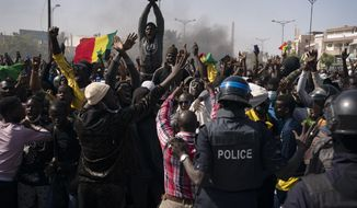 Demonstrators shout slogans in front of riot policemen during a protest against the arrest of opposition leader and former presidential candidate Ousmane Sonko, Senegal, Monday, March 8, 2021. Senegalese authorities have freed opposition leader Ousmane Sonko while he awaits trial on charges of rape and making death threats. The case already has sparked deadly protests threatening to erode Senegal's reputation as one of West Africa's most stable democracies. (AP Photo/Leo Correa)
