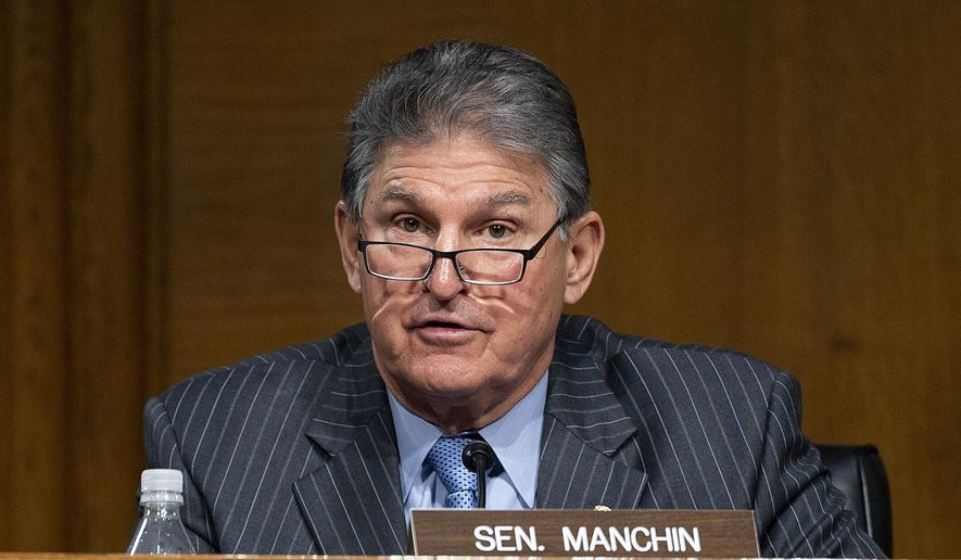In this file photo, Sen. Joe Manchin, D-WVa., speaks during a hearing to examine the nomination of former Gov. Jennifer Granholm, D-Mich., as she testifies before the Senate Energy and Natural Resources Committee during a hearing to examine her nomination to be Secretary of Energy, Wednesday, Jan. 27, 2021, on Capitol Hill in Washington. (Jim Watson/Pool via AP)  ** FILE **