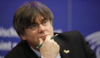 In this Monday, Jan. 13, 2020, file photo, Catalan leader Carles Puigdemont reacts during a press conference at the European Parliament in Strasbourg, eastern France. (AP Photo/Jean-Francois Badias, File)