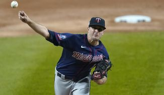 Minnesota Twins starting pitcher Jake Odorizzi delivers during the first inning of the team's baseball game against the Chicago White Sox on Wednesday, Sept. 16, 2020, in Chicago. (AP Photo/Charles Rex Arbogast)