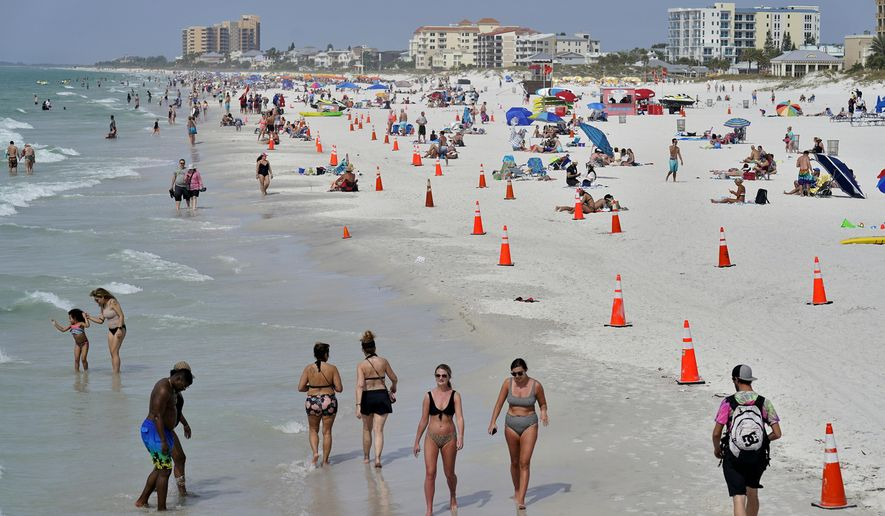Beachgoers take advantage of the weather as they spend time on Clearwater Beach Tuesday, March 2, 2021, in Clearwater, Fla., a popular spring break destination, west of Tampa. Colleges around the U.S. are scaling back spring break or canceling it entirely to discourage beachfront partying that could raise infection rates back on campus. (AP Photo/Chris O'Meara)