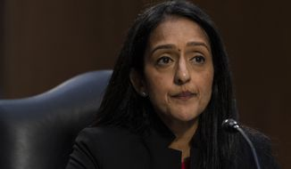Vanita Gupta, is seated during a Senate Judiciary Committee hearing to examine her nomination to be Associate Attorney General, on Capitol Hill, Tuesday, March 9, 2021, in Washington. (AP Photo/Alex Brandon)