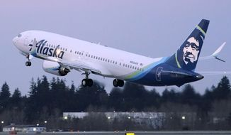 The first Alaska Airlines passenger flight on a Boeing 737-9 Max airplane takes off, Monday, March 1, 2021, on a flight to San Diego from Seattle-Tacoma International Airport in Seattle.   Boeing says it got more new orders than cancellations for planes in February.  Boeing said Tuesday, March 9, that it received 82 new orders and 51 cancellations last month, for a net gain of 31.    (AP Photo/Ted S. Warren, File)