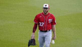 Washington Nationals starting pitcher Stephen Strasburg (37) walks to the bullpen before a spring training baseball game against the Houston Astros, Tuesday, March 9, 2021, in West Palm Beach, Fla. (AP Photo/Lynne Sladky) **FILE**