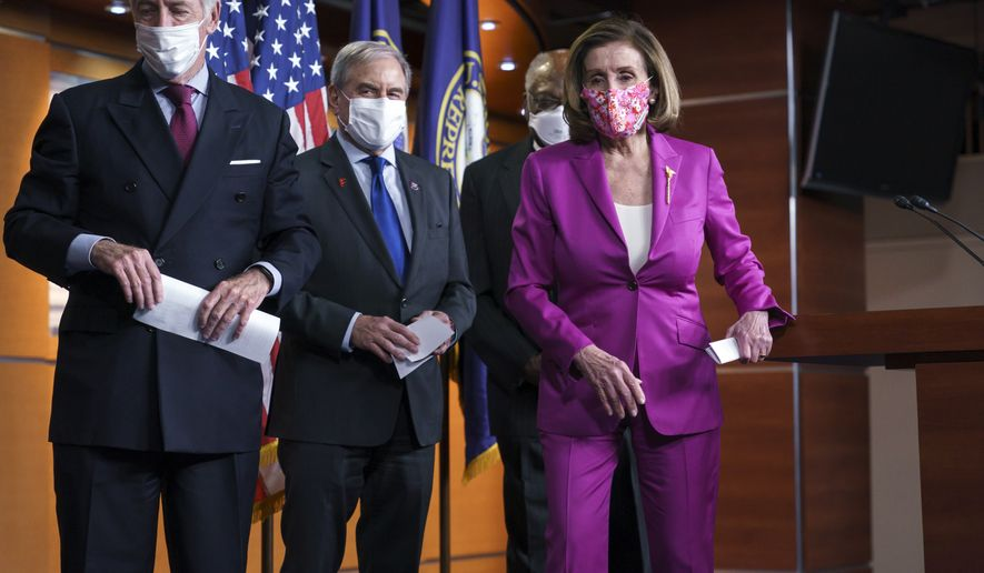Speaker of the House Nancy Pelosi, D-Calif., joined from left by Ways and Means Committee Chairman Richard Neal, D-Mass., Budget Committee Chairman John Yarmuth, D-Ky., and Majority Whip James Clyburn, D-S.C., finishes a news conference ahead of the vote on the Democrats' $1.9 trillion COVID-19 relief bill, at the Capitol in Washington, Tuesday, March 9, 2021. (AP Photo/J. Scott Applewhite)