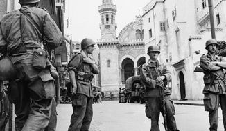 FILE - In this May 27, 1956 file photo, French troops seal off Algiers' notorious casbah, 400-year-old teeming Arab quarter. French President Emmanuel Macron announced a decision to speed up the declassification of secret documents related to Algeria's seven-year war of independence from 1954 to 1962. (AP Photo, File)