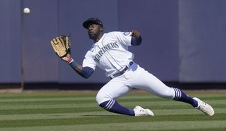 Seattle Mariners center fielder Taylor Trammell catches a fly ball hit by Oakland Athletics' Greg Deichmann during the second inning of a spring training baseball game Saturday, March 6, 2021, in Peoria, Ariz. (AP Photo/Sue Ogrocki)