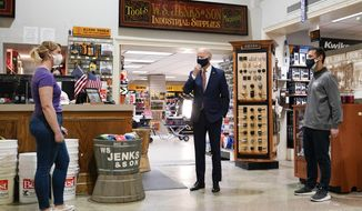 President Joe Biden speaks with Mary Anna Ackley, Owner of Little Wild Things Farm, left, and Michael Siegel, Co-owner of W.S. Jenks & Son, right, during a visit at W.S. Jenks & Son hardware store, a small business that received a Paycheck Protection Program loan, Tuesday, March 9, 2021, in Washington. (AP Photo/Patrick Semansky)