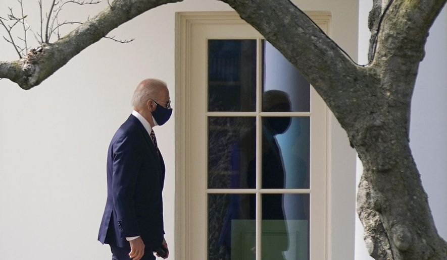 President Joe Biden walks to the Oval Office of the White House, Tuesday, March 9, 2021, in Washington. Biden is returning to the White House after visiting W.S. Jenks & Son hardware store, a small business that received a Paycheck Protection Program loan. (AP Photo/Patrick Semansky)