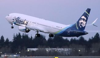 FILE - The first Alaska Airlines passenger flight on a Boeing 737-9 Max airplane takes off, Monday, March 1, 2021, on a flight to San Diego from Seattle-Tacoma International Airport in Seattle.   Boeing says it got more new orders than cancellations for planes in February.  Boeing said Tuesday, March 9, that it received 82 new orders and 51 cancellations last month, for a net gain of 31.    (AP Photo/Ted S. Warren, File)