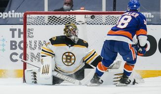 New York Islanders' Anthony Beauvillier (18) shoots the puck past Boston Bruins goaltender Jaroslav Halak (41) during the shootout period of an NHL hockey game Tuesday, March 9, 2021, in Uniondale, N.Y. The Islanders won 2-1. (AP Photo/Frank Franklin II)