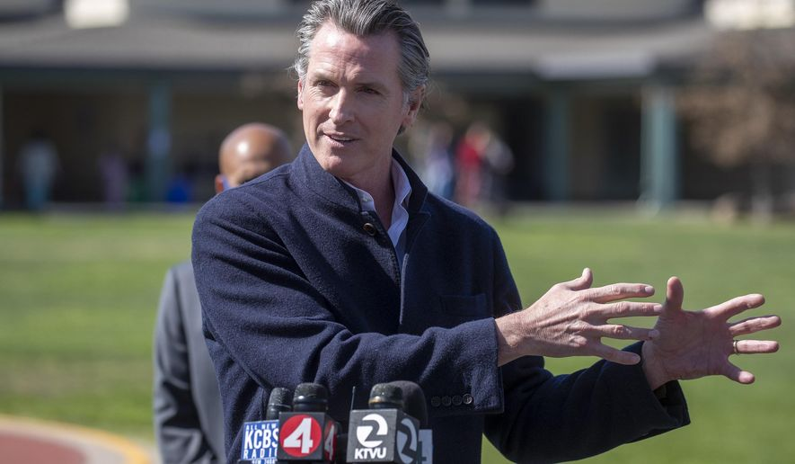 FILE - In this March 2, 2021 file photo California Gov. Gavin Newsom speaks about the state's plan to reopen schools as coronavirus vaccinations continue during a news conference on the schoolyard at Barron Park Elementary in Palo Alto, Calif. The annual State of the State address Newsom will deliver on Tuesday, March 9, 2021, will be one of the most important speeches of his political career. It comes about a year after his first coronavirus stay-at-home order and as he faces a potential recall election. (Karl Mondon/Bay Area News Group via AP, File)