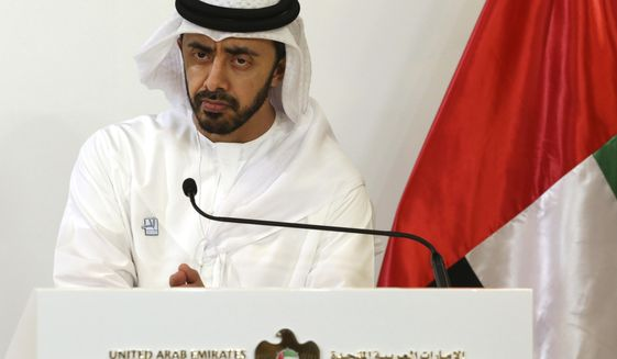 FILE - In this June 9, 2019 file photo, United Arab Emirates Foreign Minister Sheikh Abdullah bin Zayed Al Nahyan listens during a news conference in Abu Dhabi, United Arab Emirates. Al Nahyan said Tuesday, March 9, 2021, that U.S. sanctions against the government of Syrian President Bashar Assad have undermined efforts to bring a regional settlement to the Syrian conflict. In a joint press conference in Abu Dhabi with his Russian counterpart, Emirati Foreign Minister Abdullah bin Zayed Al Nahyan said American economic pressure campaign makes joint cooperation difficult. (AP Photo/Jon Gambrell, File)