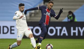 PSG's Neymar, right, is challenged by Marseille's Alvaro during the French League One soccer match between Olympique de Marseille and Paris Saint-Germain at the Velodrome stadium in Marseille, southern France, Sunday, Feb. 7, 2021. (AP Photo/Daniel Cole)