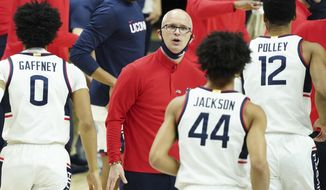 Connecticut head coach Dan Hurley greets his players a break against Georgetown in the first half of an NCAA college basketball game Saturday, March 6, 2021, in Storrs, Conn. (David Butler II/Pool Photo via AP)