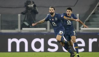 Porto's Sergio Oliveira celebrates, with Luis Diaz, right, after scoring his side's second goal during the Champions League, round of 16, second leg, soccer match between Juventus and Porto in Turin, Italy, Tuesday, March 9, 2021. (AP Photo/Luca Bruno)