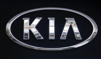 FILE - In this Feb. 14, 2019 file photo, the KIA logo is displayed on a sign at the 2019 Pittsburgh International Auto Show in Pittsburgh. Kia is telling owners of nearly 380,000 vehicles in the U.S. to park them outdoors due to the risk of an engine compartment fire. The Korean automaker is recalling certain 2017 through 2021 Sportage SUVs and 2017 through 2019 Cadenza sedans to fix the problem. (AP Photo/Gene J. Puskar, File)