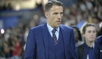 England head coach Phil Neville walks onto the field before a SheBelieves Cup women's soccer match against the United States Wednesday, March 7, 2018, in Orlando, Fla. Phil Neville says the excitement for his new gig at Inter Miami still feels fresh, even though he took the job back in January. Neville led England to the Women's World Cup semifinals in 2019. It was expected that he'd take the team to the Olympics in Tokyo this summer, but he left early coach David Beckham's Major League Soccer team. (AP Photo/Phelan M. Ebenhack)