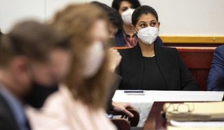 Des Moines Register reporter Andrea Sahouri listens to opening statements in her trial in which she is charged with failure to disperse and interference with official acts while reporting on a protest last summer, Monday, March 8, 2021, at the Drake University Legal Clinic, in Des Moines, Iowa. (Kelsey Kremer/The Des Moines Register via AP)